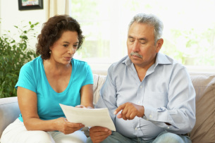 Customers looking over loan documents at home